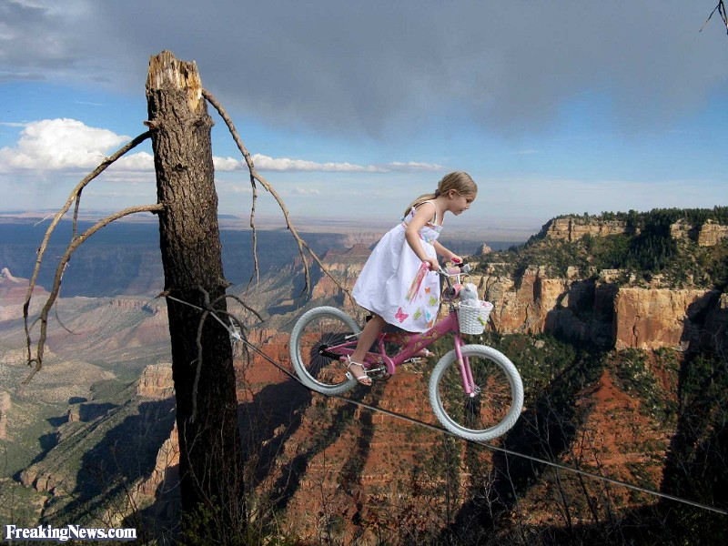 Girl-Riding-Bike-Over-Grand-Canyon--93300